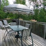 Private upper level deck with patio furniture and BBQ