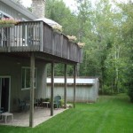 Plenty of lush lawn; lower deck access